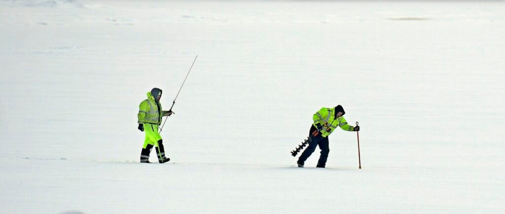US Geological Service hydrological technicians Jason Cyr, right, and Jeremiah Pomerleau pound ice Wednesday on the Kennebec River in Gardiner while collecting samples. The federal agency was collecting data on the thickness of ice from rivers across Maine ahead of a flood watch meeting with the Maine Emergency Management Agency on Thursday.