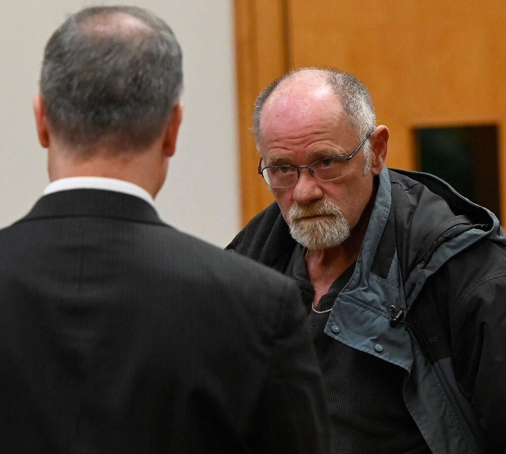 Raymond Files, right, appears in Biddeford District Court on Wednesday with his attorney, Roger Champagne. Files pleaded no contest to a charge of misdemeanor assault for hitting an autistic student.