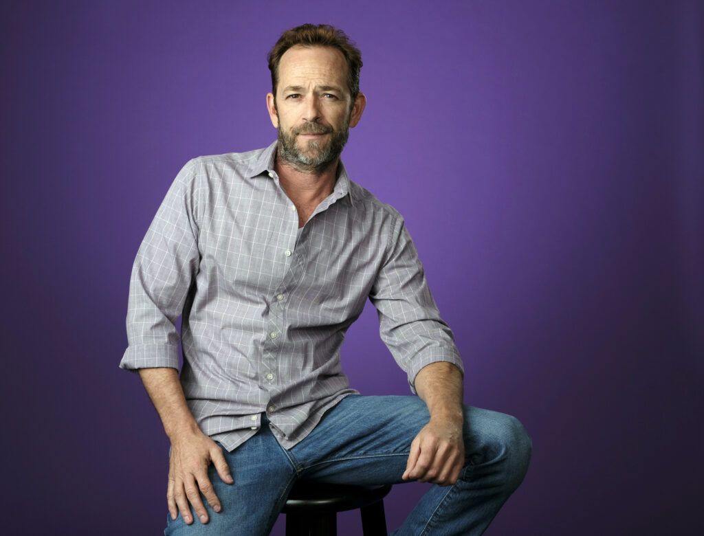 """In this Aug. 6, 2018, file photo, Luke Perry, a cast member in the CW series """"Riverdale,"""" poses for a portrait during the 2018 Television Critics Association Summer Press Tour in Beverly Hills, Calif. Perry died Monday at the age of 52 after suffering a stroke."""