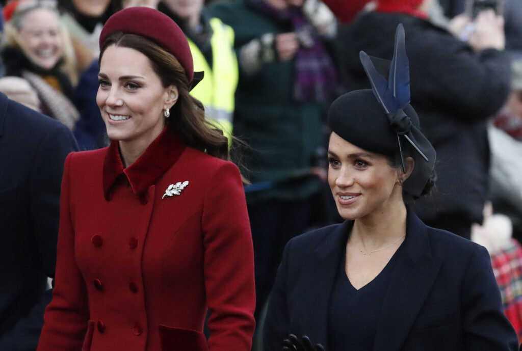 In this Tuesday, Dec. 25, 2018 file photo, Britain's Kate, Duchess of Cambridge, left, and Meghan, Duchess of Sussex arrive to attend the Christmas day service at St Mary Magdalene Church in Sandringham in Norfolk, England. Britain's royal family is warning that it will block trolls posting offensive messages on its social media channels _ and may report offenders to the police. Buckingham Palace, Clarence House and Kensington Palace issued new guidelines on Monday, March 4, 2019 spelling out the policy banning offensive, hateful and racist language.