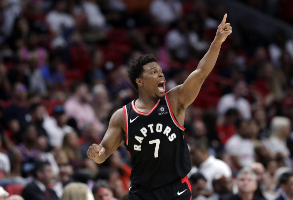 Toronto guard Kyle Lowry reacts after shooting a 3-pointer during the second half of the Raptors' 125-104 win over the Miami Heat on Sunday in Miami.