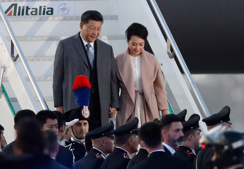 Chinese President Xi Jinping and his wife, Peng Liyuan, arrive at Rome's Leonardo Da Vinci airport in Fiumicino, Italy, on Thursday. Jinping is in Italy to sign a memorandum of understanding to make Italy the first Group of Seven leading democracies to join China's ambitious Belt and Road infrastructure project.