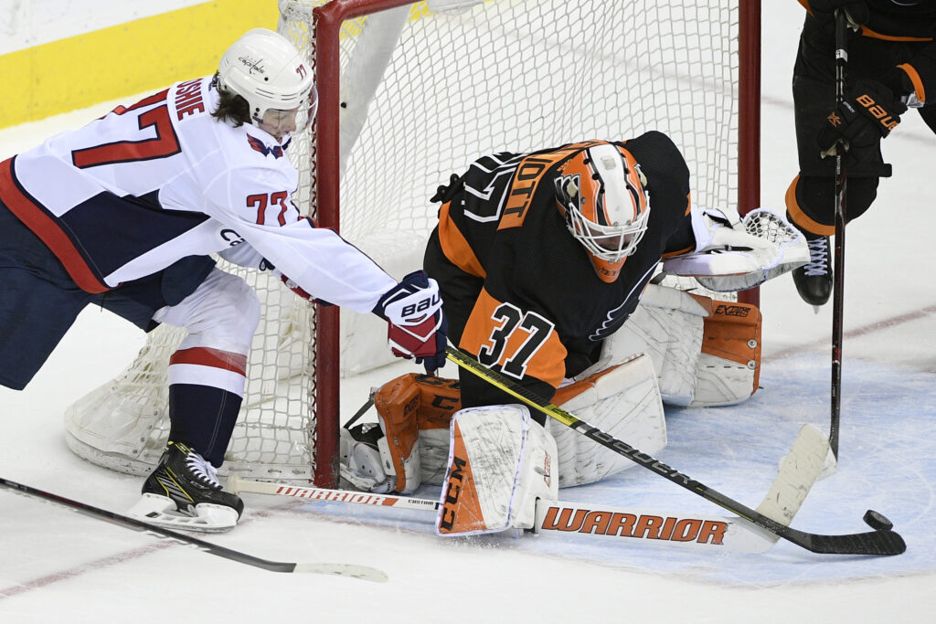 Washington Capitals right wing T.J. Oshie tries to get the puck past Philadelphia Flyers goaltender Brian Elliott during the Capitals' 3-1 win Sunday in Washington.