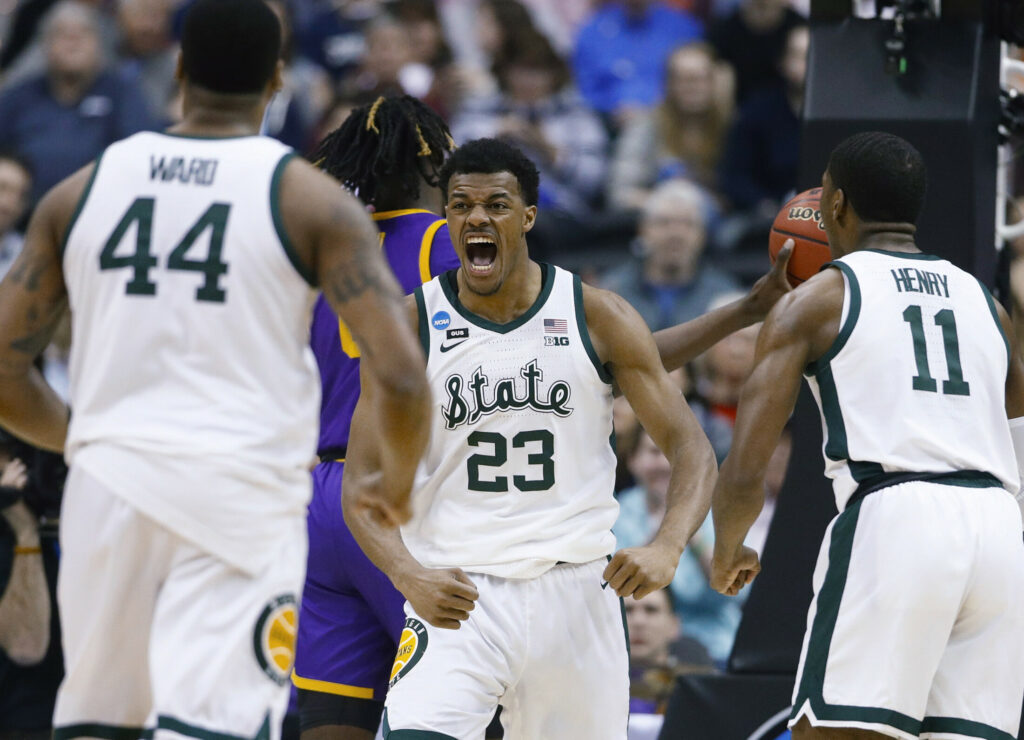 Michigan State's Xavier Tillman celebrates a basket with teammates Nick Ward, left, and Aaron Henry during an 80-63 win over LSU in an East Regional semifinal Friday night.