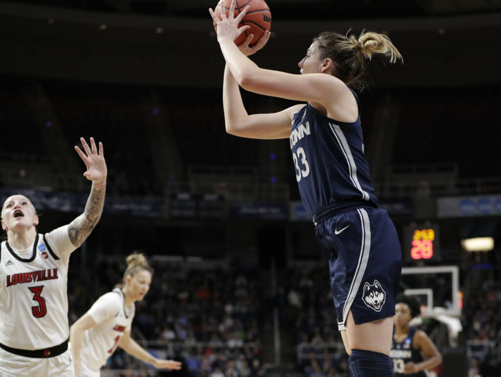 Louisville forward Sam Fuehring defends as UConn guard Katie Lou Samuelson takes a shot from the perimeter during the Huskies' 80-73 win on Sunday in Albany. UConn advances to its 12th straight Final Four with the victory.