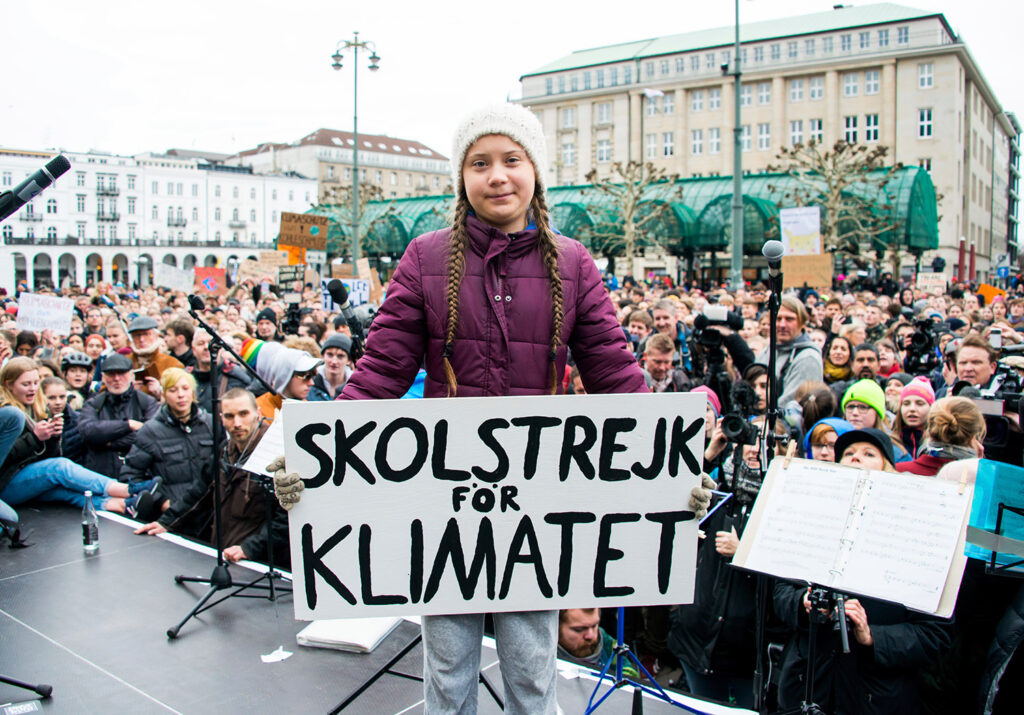 """Swedish climate activist Greta Thunberg holds a protest poster as she attends a protest rally in Hamburg, Germany, on March 1. The slogan reads '""""School Strike For The Climate."""" Today's Maine Voices columnists say Thunberg has quickly risen to international hero status on social media for her straight-to-the-point truth-telling to politicians and CEOs about the """"unimaginable amounts of money"""" made by those sacrificing their future."""