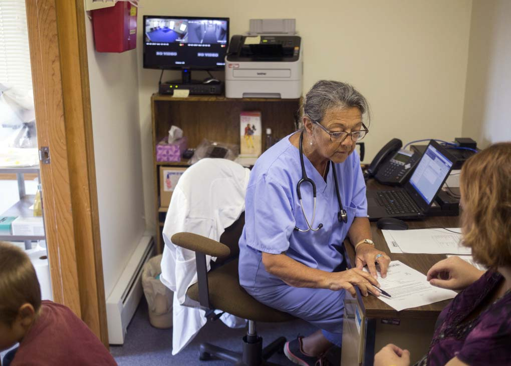 Priscilla Perry, a nurse practitioner with Maine Family Planning, consults with one of her patients at her Machias office in 2017. She applauds efforts to remove barriers to reproductive health services in rural Maine.