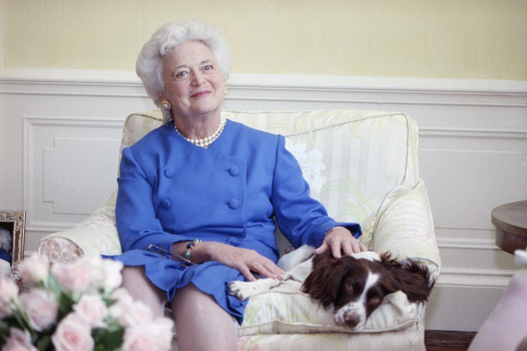 "First Lady Barbara Bush, shown with her dog Millie in 1990, is described in a new book as suffering ""angst"" over the candidacy of Donald Trump."