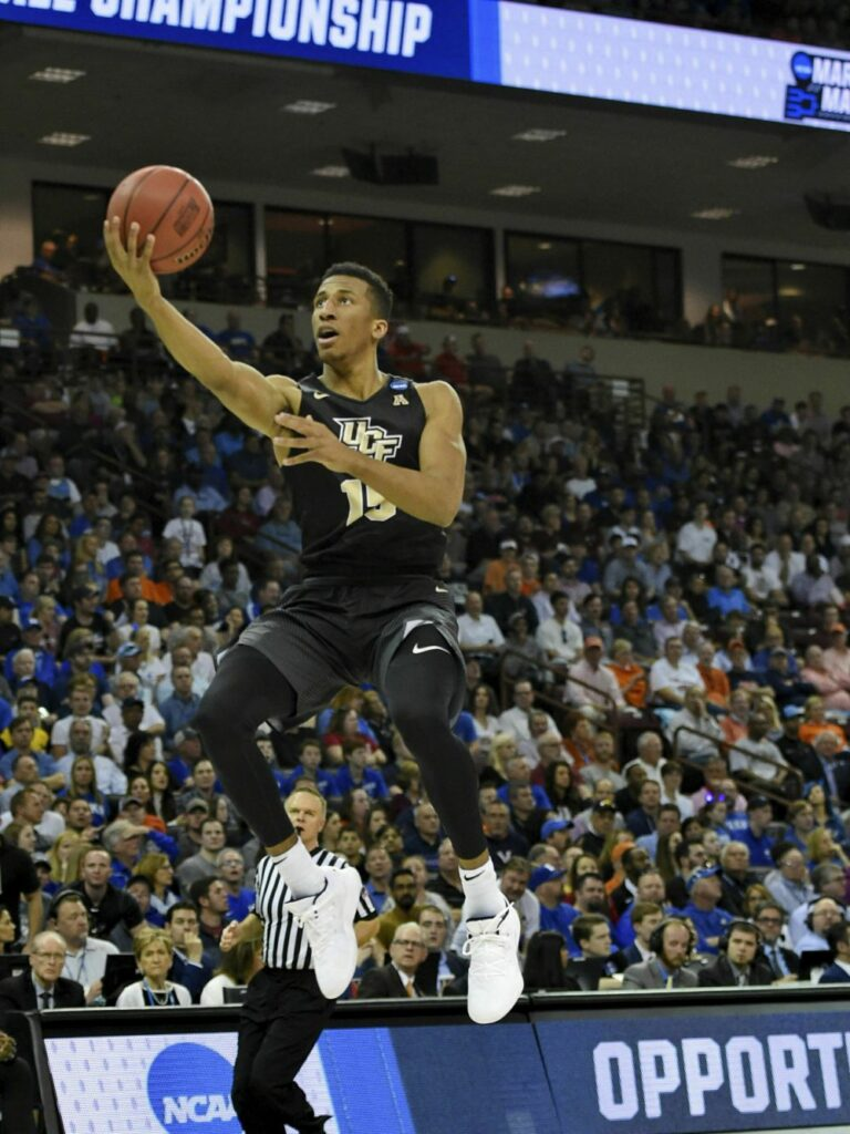 Central Florida's Aubrey Dawkins drives in for a layup during the first half of Sunday's game against Duke. Dawkins missed at the buzzer, sending Duke to a win.
