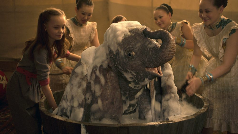 "Nico Parker, left, in a scene from ""Dumbo."""