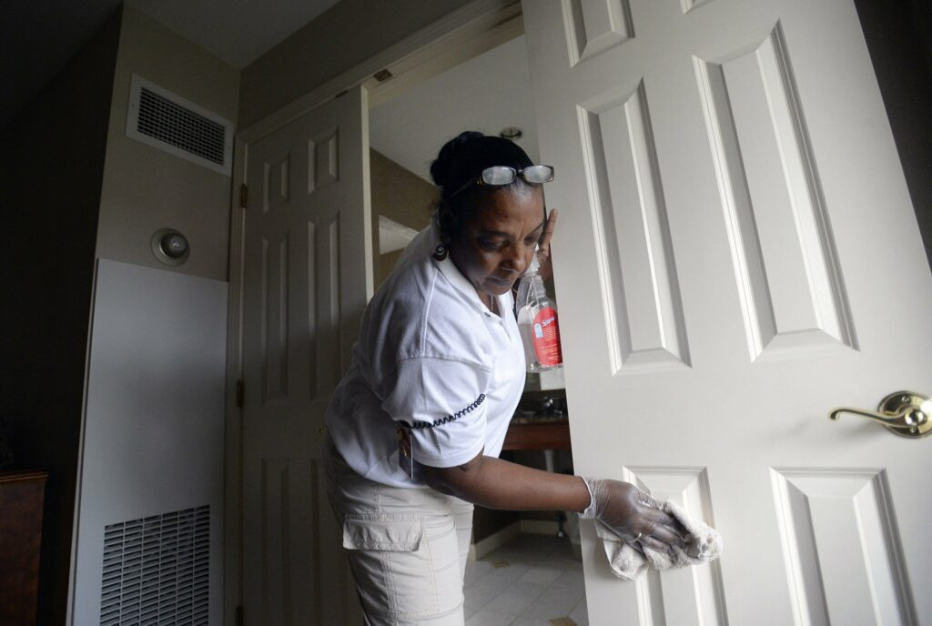 Merlene Warren of Montego Bay, Jamaica, cleans a guest room at the Meadowmere Resort in Ogunquit in 2013. Warren was working temporarily in the U.S. with an H-2B Visa.