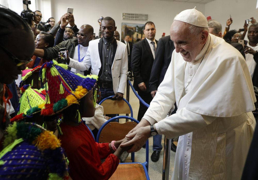 Pope Francis meets migrants at the diocesan Caritas center in Rabat, Morocco, Saturday. Francis's weekend trip to Morocco aims to highlight the North African nation's tradition of Christian-Muslim ties while also letting him show solidarity with migrants at Europe's door.
