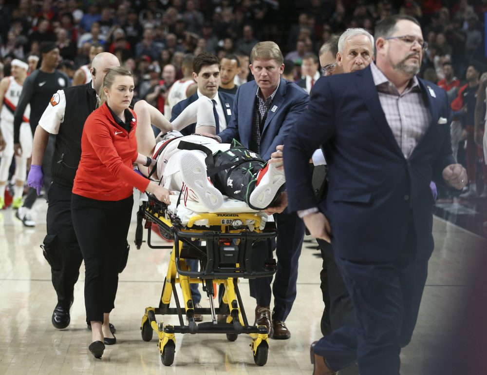 Portland Trail Blazers center Jusuf Nurkic, center, was injured and left the court on a stretcher as the Blazers beat the Brooklyn Nets in double overtime, 148-144, Monday night.