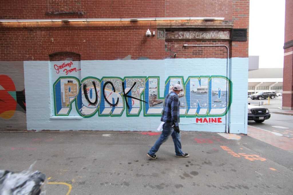 "Artist Mike Rich surveys the mural he made for ""Puckland."""