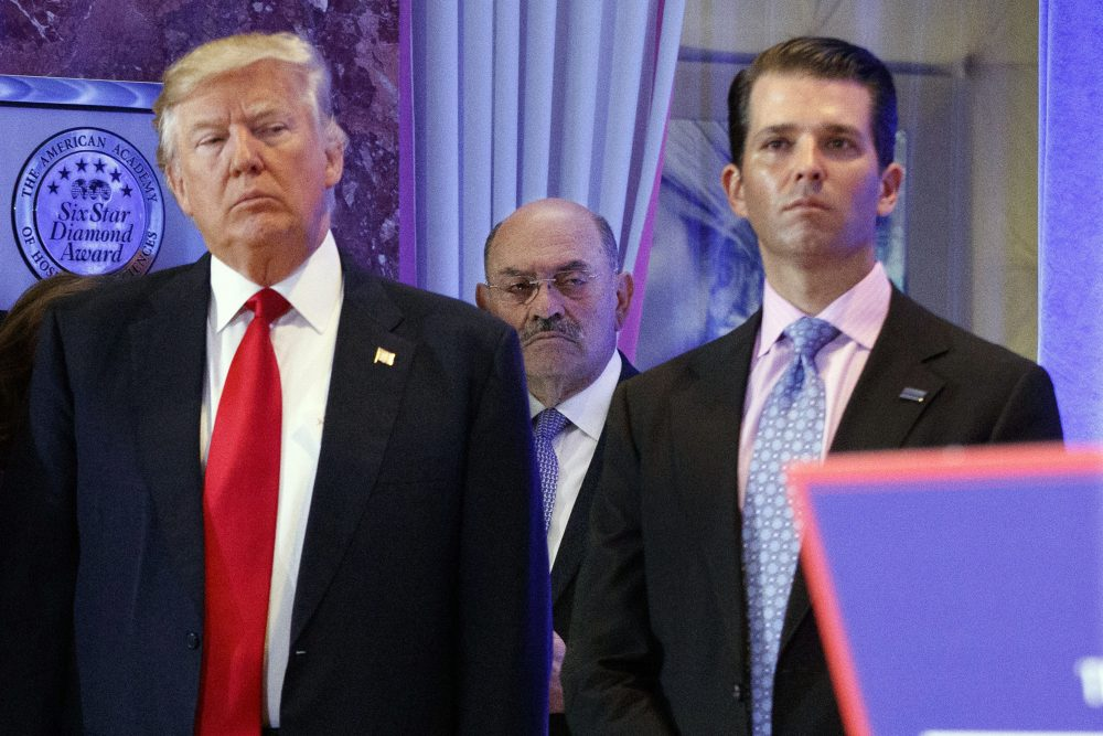 Allen Weisselberg, center, stands between President-elect Donald Trump, left, and Donald Trump Jr., at a news conference in the lobby of Trump Tower in New York in Jan. 2017. Weisselberg, chief financial officer for Donald Trump, is now in the sights of the federal probes and congressional investigations of President Donald Trump's family business.