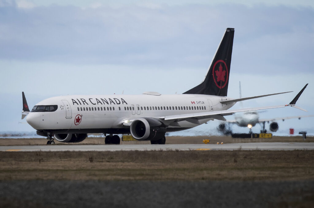 Air Canada is looking into how crew members could have disembarked from a plane without noticing a sleeping passenger who was left behind.