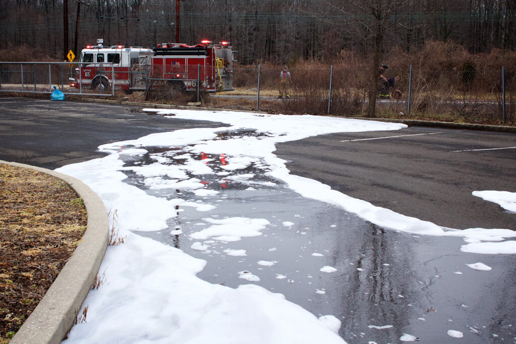 Firefighting foam remains on the ground after a tanker truck accident in Bensalem, Pa., on Feb. 7. The governor's task force will work to determine how much PFAS-containing firefighting foam is around Maine and identify potential alternatives.