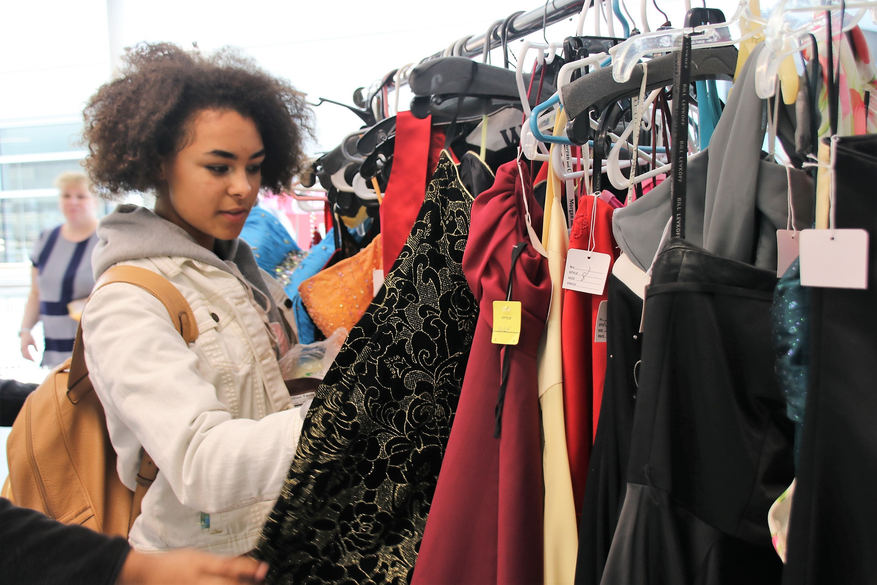 615f2fb13 Annibelle Reeves, a junior at Sanford High School, sorts through prom gowns  at Sanford High School and Regional Technical Center on Thursday.