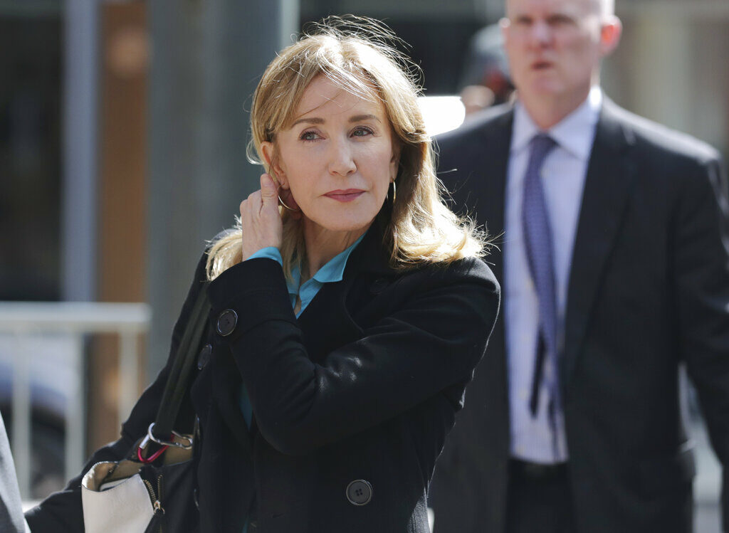 Actress Felicity Huffman arrives at federal court in Boston in April. U.S. Attorney Andrew Lelling's office urged a judge to sentence Huffman to one month of incarceration, 12 months of supervised release and a $20,000 fine.