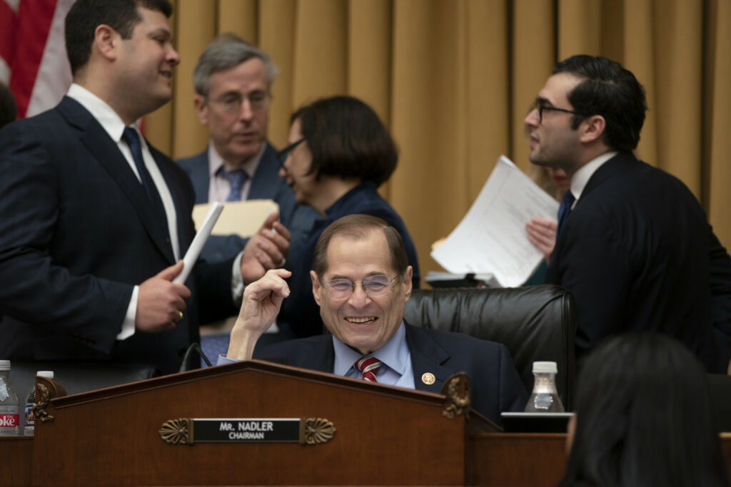 House Judiciary Committee Chair Jerrold Nadler, D-N.Y., surrounded by his staff, passed a resolution to subpoena special counsel Robert Mueller's full report Wednesday.