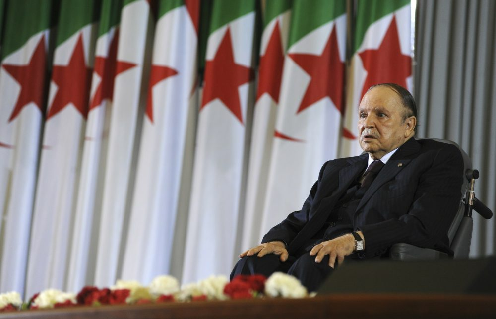 Algerian President Abdelaziz Bouteflika sits in a wheelchair in 2014. Weekly protests have demanded that he step down.