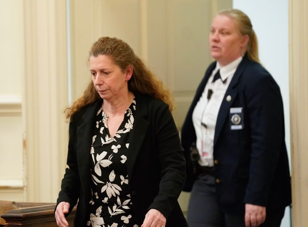"""Carol Sharrow of Sanford, left, enters the courtroom Tuesday in York County Superior Court to face charges in last year's hit-and-run death of Douglas Parkhurst. Sharrow, who drove onto a baseball field in Sanford during a game in June, was committed to the Riverview Psychiatric Center as the judge found she has """"an acute psychiatric illness."""""""