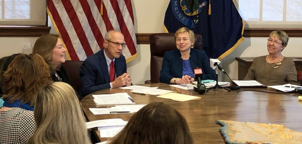 Gov. Janet Mills, center, listens as Gordon Smith, director of opioid response for the state, addresses the first gathering of the governor's Prevention and Recovery Cabinet on Wednesday at the State House.