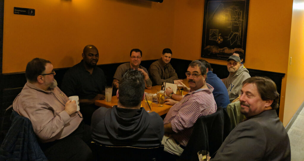 Four members of the Waterville City Council gathered with Mayor Nick Isgro and others at Portland Pie Company after the council meeting on Tuesday. From left are Councilors Michael Morris, Phil Bofia, Jay Coelho with his back to the camera, and Sidney Mayhew. Mayor Nick Isgro is in the far corner. Waterville resident Rien Finch has requested the city to investigate the legality of the gathering. When three or more city councilors gather, it may, under circumstances defined in the Maine Freedom of Access Law, constitute an illegal meeting.