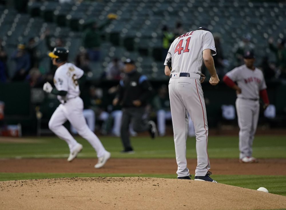 Boston Red Sox pitcher Chris Sale (41) stands on the mound after allowing a solo home run to Oakland Athletics' Matt Chapman, left, during the first inning of a baseball game in Oakland, Calif.