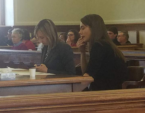 Kelsey Campbell, right, is shown in April 2018 with her attorney, Laura Shaw.