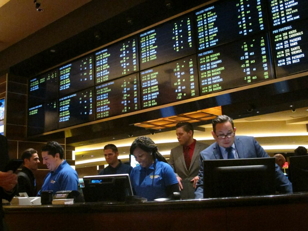 FILE - In this Oct. 25, 2018, file photo, employees prepare to take bets moments before the new sports book at the Tropicana casino in Atlantic City, N.J., opened. Most of the states that moved quickly to legalize sports betting after a Supreme Court decision last year are still waiting for the expected payoff. Only New Jersey and Delaware saw the tax revenue to their state budgets meet projections. (AP Photo/Wayne Parry, File)