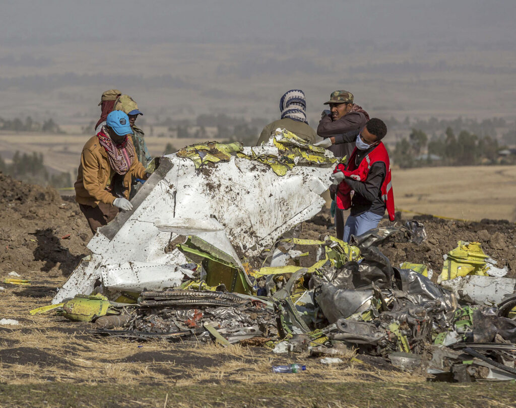 Rescuers work at the scene of the Ethiopian Airlines flight crash near Bishoftu, Ethiopia in March.