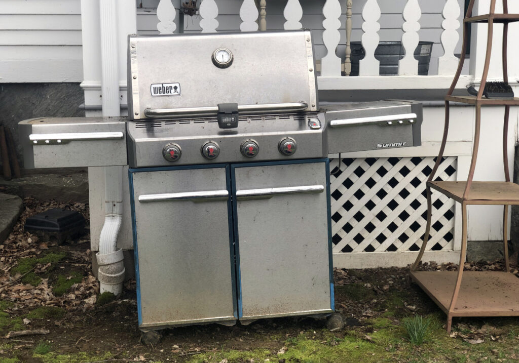 In this April 14 photo, a grill sits outside a home in New Milford, Conn., in need of some upkeep after sitting unused during the winter months.