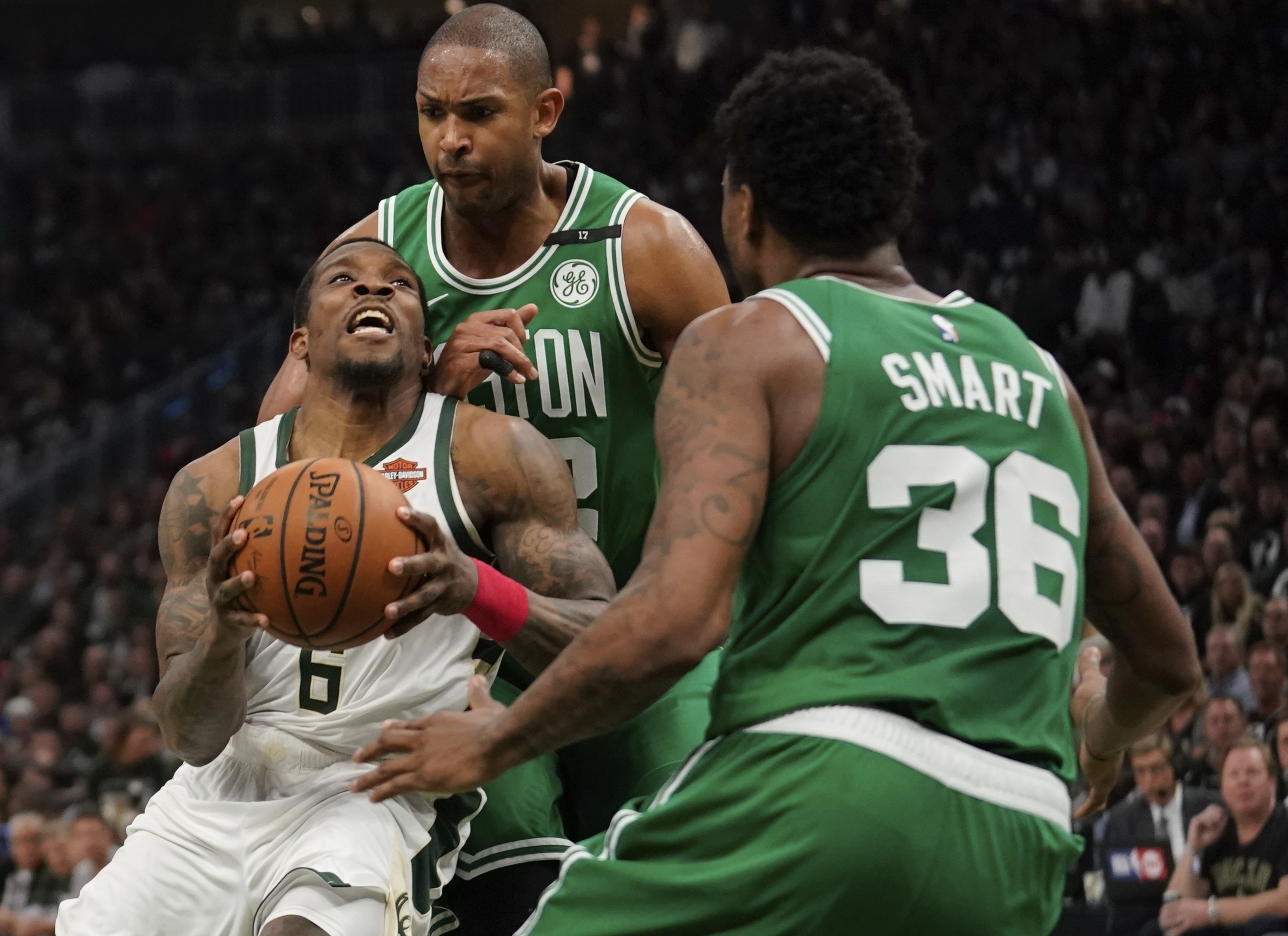 cba3efad165a Milwaukee Bucks  Eric Bledsoe tries to drive past Boston Celtics  Al  Horford and Marcus Smart during the first half of Game 5 of a second round  NBA ...