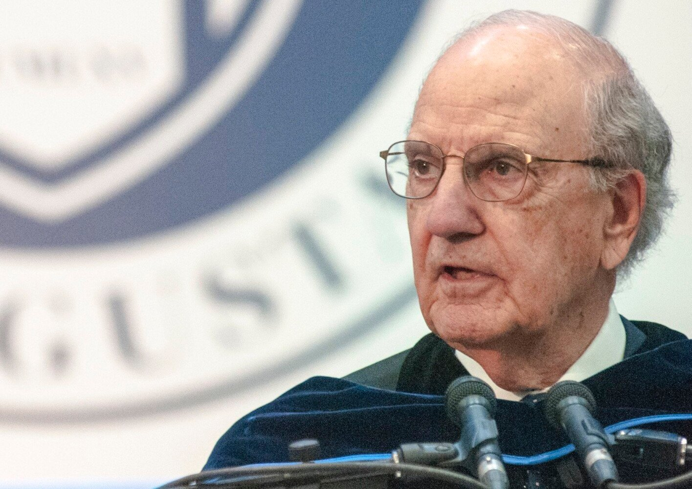 George Mitchell gives the commencement address during the University of Maine at Augusta graduation on May 12, 2018.
