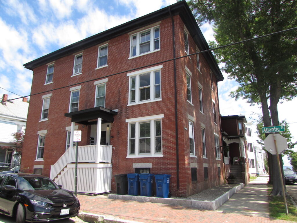 The renovated brick property at 55 Atlantic Street has eight units.