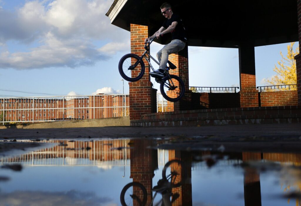 Dom Green, 17, of Saco, jumps over steps while riding with friends at Mechanics Park in Biddeford on Wednesday. Mechanics Park is at the corner of Maine and Water streets where you can see the Saco River and walk the paths. Or ride your bike.
