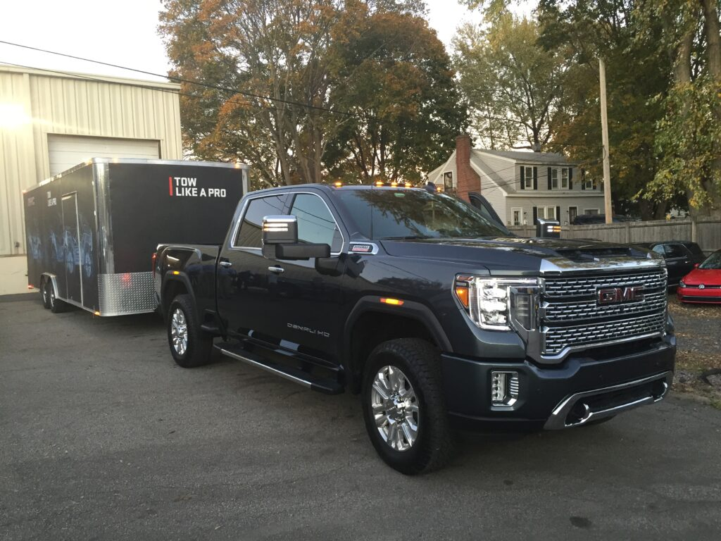 This sample Denali was hooked to a boxed car carrier, which had a brand new 2020 GMC Canyon pickup inside.