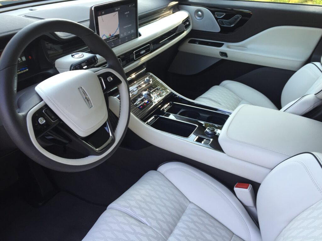 Touchscreens are complimented by a plethora of knobs and conventional controls in the cabin. The transmission control is a piano-key-like horizontal series of buttons in the middle of the dash.
