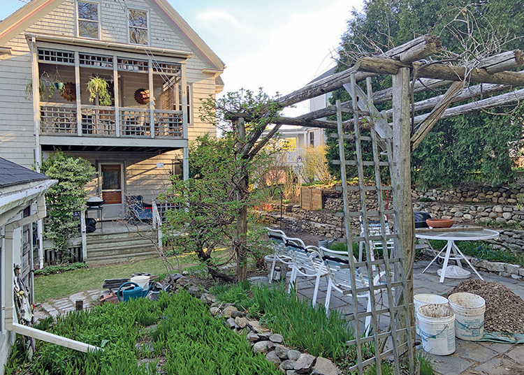 Gregory Adams's backyard in Portland's Oakdale neighborhood is full of DIY projects, from his pergola covered patio to the terraced gardens. His composting system, rear center, is seamlessly integrated into the landscaping.