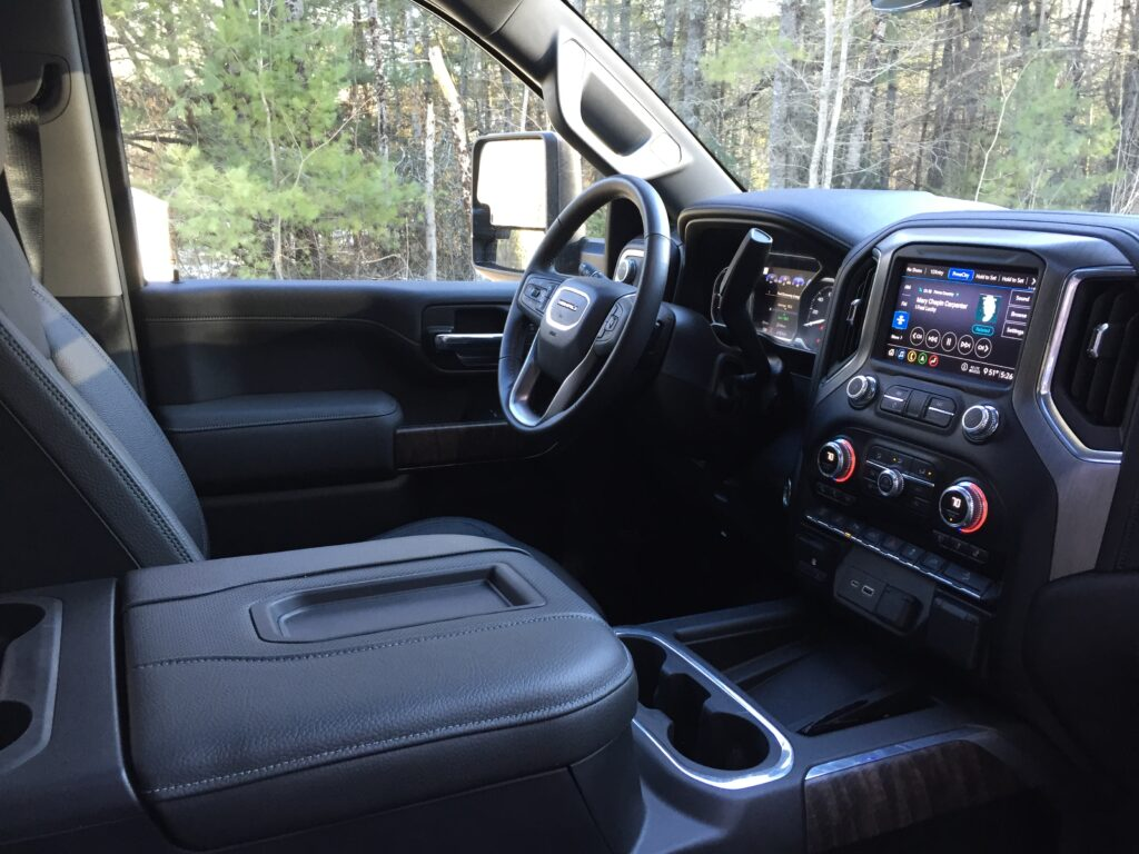 "Our reviewer writes that ""the look and the feel of the Denali's cabin materials isn't as opulent, nor as luxurious, as the premium versions of the Ford Super Duty and the Ram. With a sticker price a whisker under $80,000, those new tech components are needed to sway consumers not brand-loyal."""