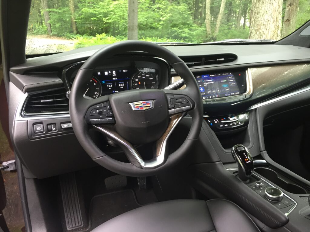 Cadillac has continued to refine its center-dash info-entertainment system, but without any knobs, this touchscreen requires too many precise finger inputs for tour reviewer's taste.