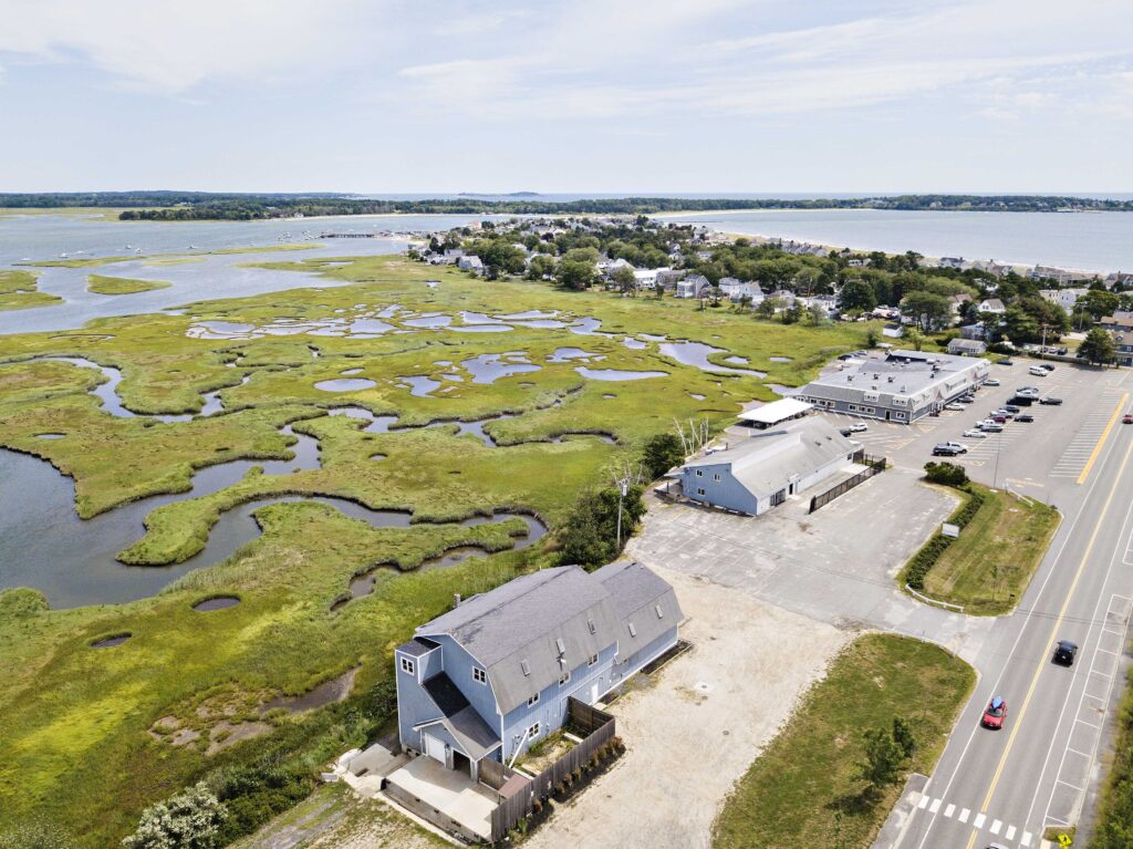 Aerial view of the two properties at 350 Pine Point Rd. Clambake Seafood is at the top of the photo.