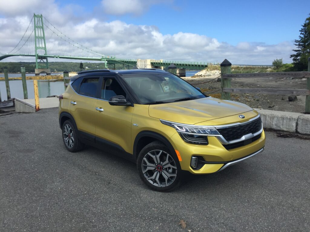 The Seltos immediately sets itself apart from its primary rivals with more distinctive styling—brilliant Starbright Yellow paint and a black roof.. $21,990 is the base price, shown here at $29,485.