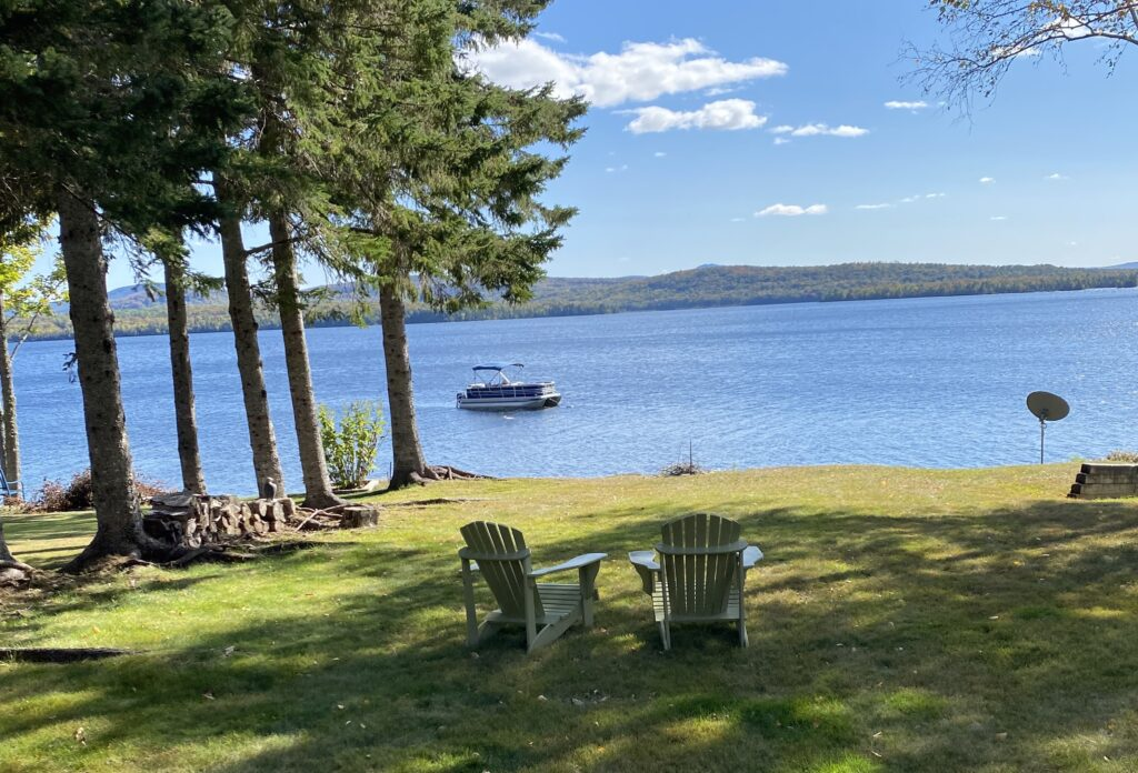 The home is tucked on Smith Cove, looking at the sunrise over Saddleback Mountain. Loons, eagles, salmon, trout and smallmouth bass are natural neighbors.