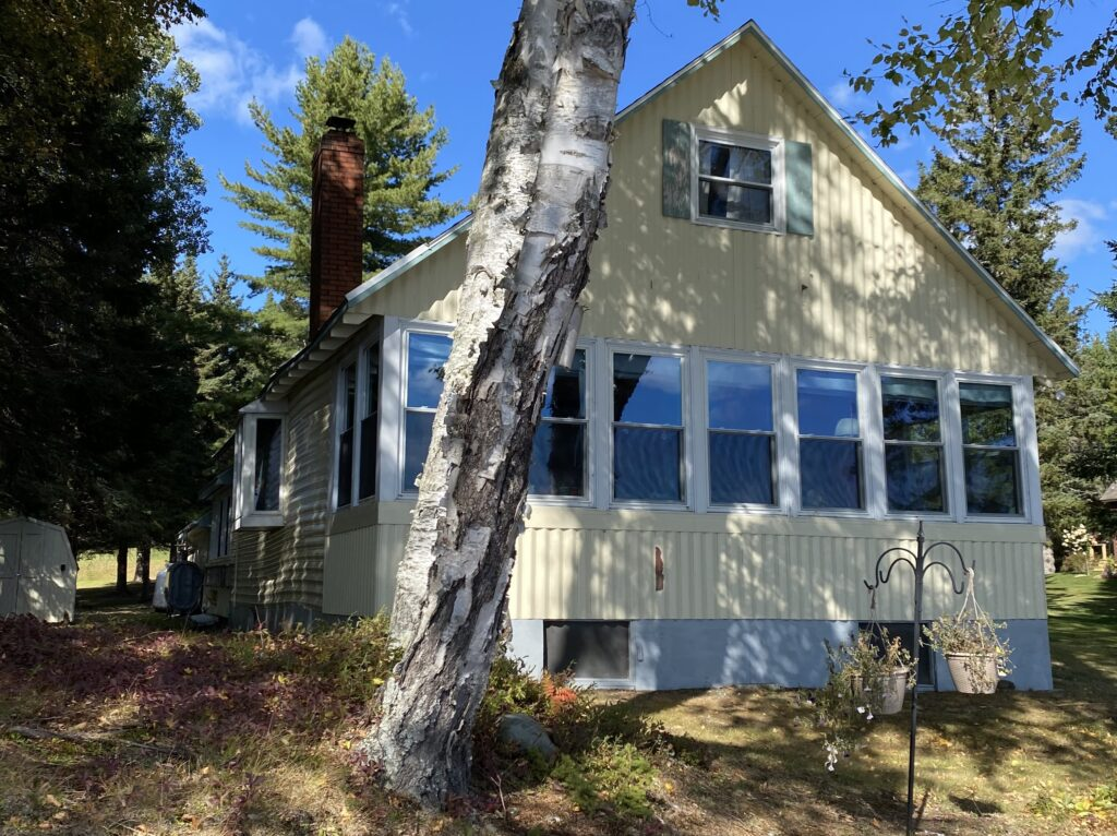 Set on 100 feet ± of Rangeley Lake, this year-round home has three bedrooms, one bathroom and a two-car garage, a somewhat rare find in this area.