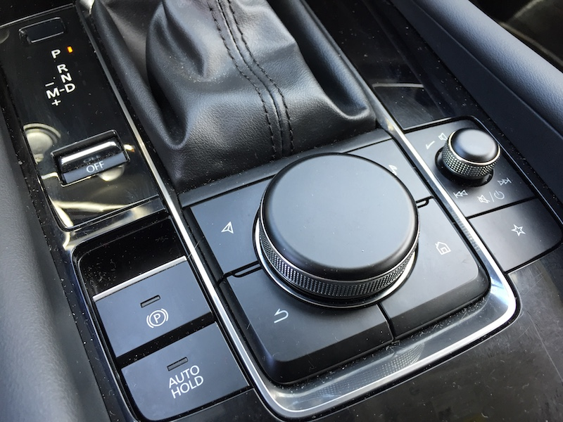 Our reviewer found Mazda's lane keeping assist sensor startling,  forcibly applying steering pressure while shaking the wheel, sounding an alarm. However, there is a deactivation button on the dash.
