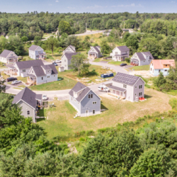 An aerial photograph of a Habitat for Humanity-built neighborhood in Scarborough on a sunny day.