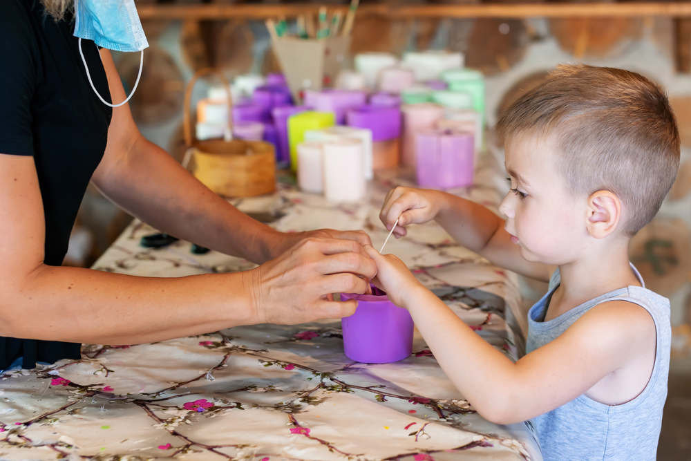 Making gifts for people this year, like unique candles, could be a great family activity.