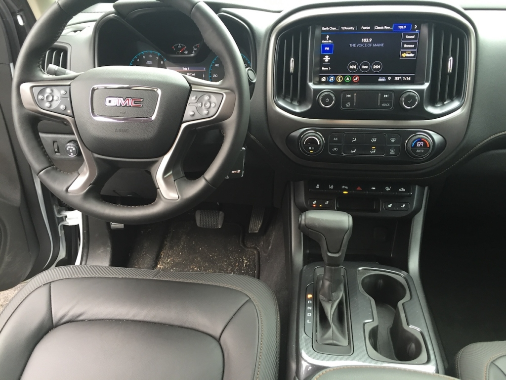 GMC Canyon AT4 trim includes, auto-locking rear diff, descent control, remote starting, wireless charging, 6-way power driver's seat, 4-way power passenger seat, heated leather, heated wheel, auto-climate and more.